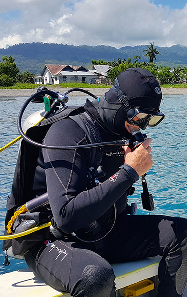 Scuba Divers Roll​ Backward
